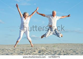 Stock-photo-loving-mature-couple-on-a-background-of-clear-sky-147680771